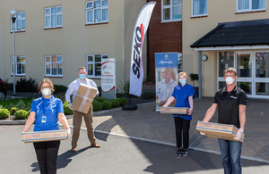 Seko Logistics employees delivering donated PPE