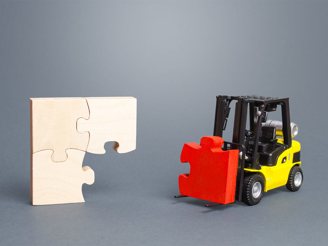 Toy forklift bringing missing puzzle piece to puzzle