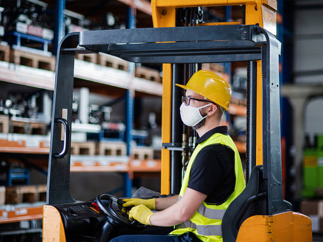 Person driving forklift