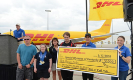 DHL employees with giant check in front of DHL airplane