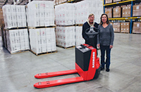People in warehouse with pallet jack