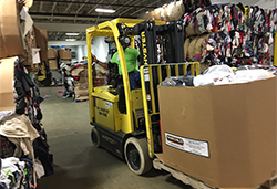 Lift truck carrying donated clothing