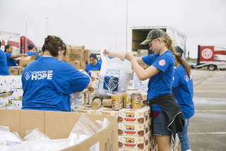 Hormel food being loaded by Convoy of Hope