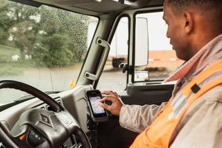 Man in truck looking phone screen
