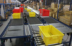 Red and yellow totes on conveyor