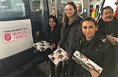 Transervice Logistics employees donating toys