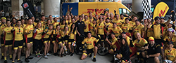 DHL employees in bike uniforms