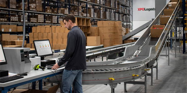 XPO releases COO, scales back acquisition plans