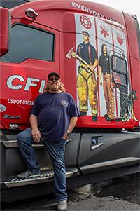 Truck driver standing in front of CFI truck