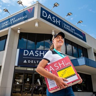 Courier in front of Dash building