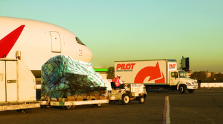 Pilot Freight Services plane and truck with cargo