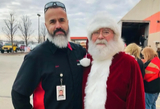 XPO employee with Santa