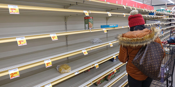 Shopper in store with empty shelves