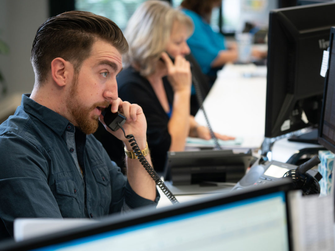 Employees on the phone at New Age Logistics