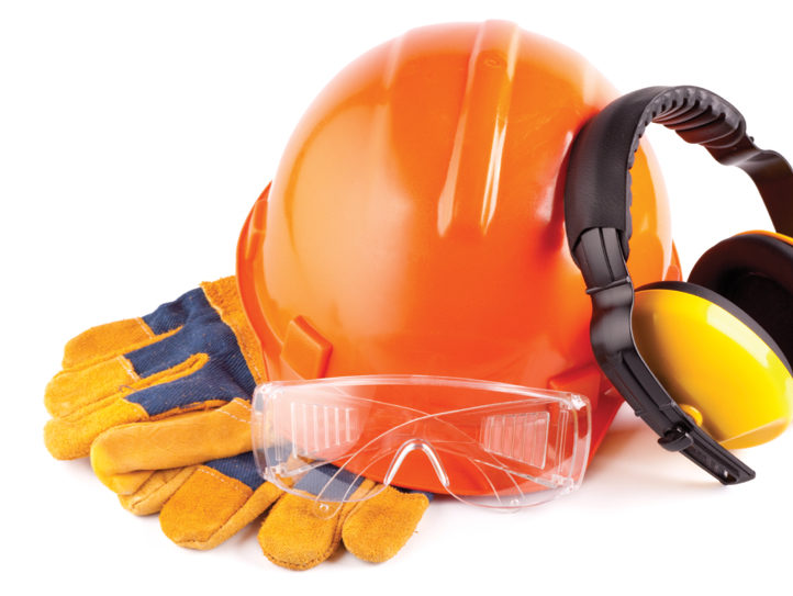 Hard hat, headphones, and work gloves