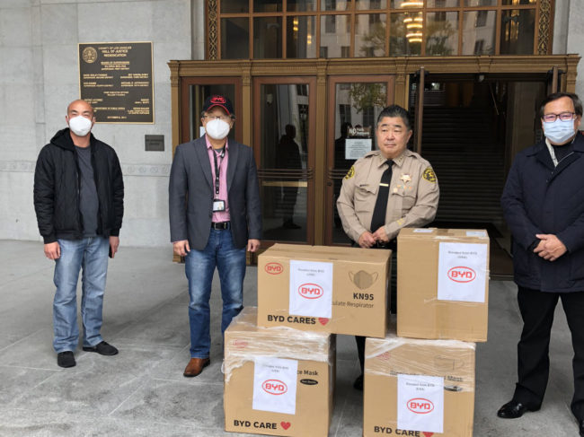 BYD employees with boxes of PPE