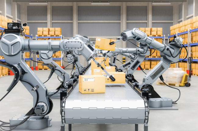Robotic arms picking up boxes on conveyors
