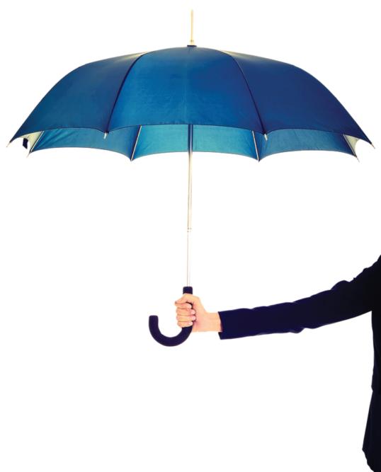 Businessperson holding up open umbrella