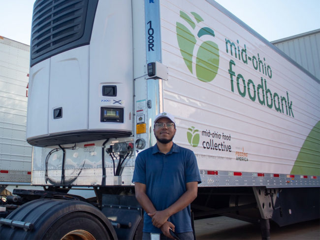 Carrier Transicold employee with food bank truck
