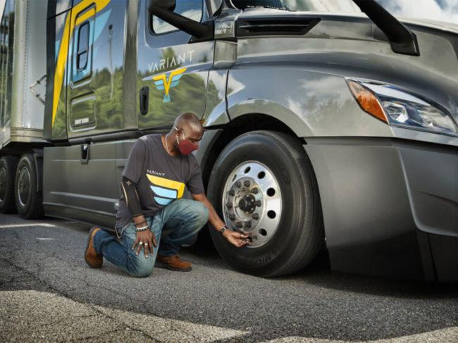 Person checking truck tire